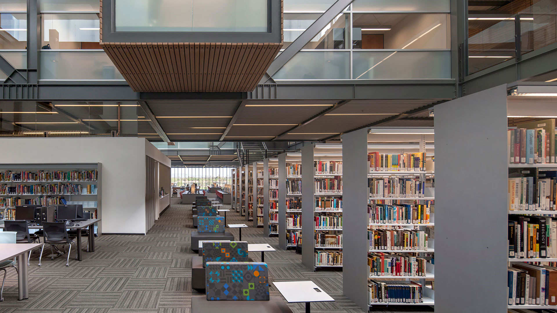 white baux library estrella hall stack space integrated technology 1920x Estrella Hall + Classrooms, Library